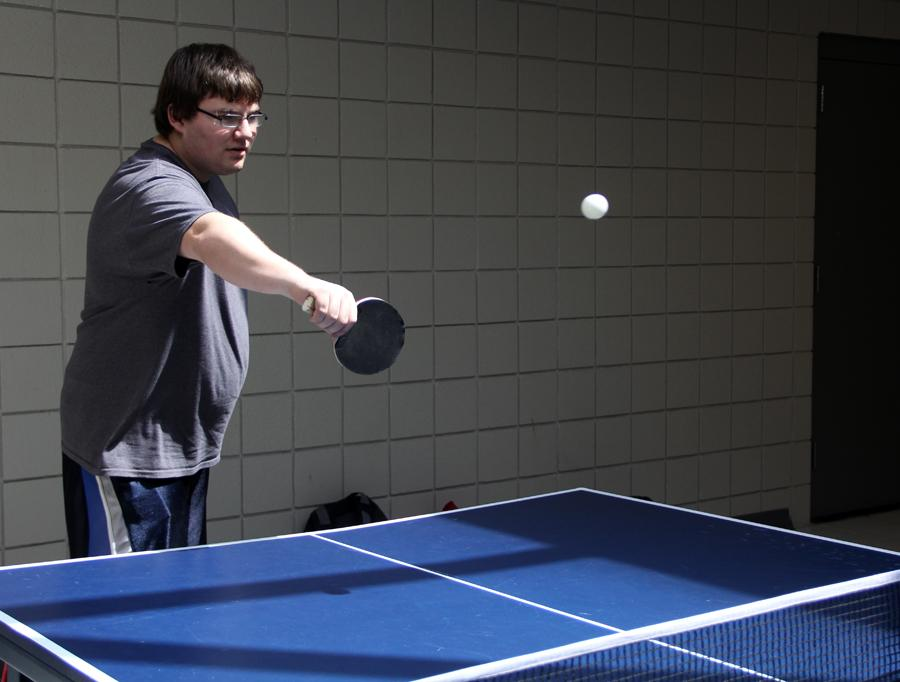 Daniel Fox (12) volleys the ball back to his partner Peter Boyd (12). Table Tennis Club meets every other Wednesday in the upstairs freshman center hallway.