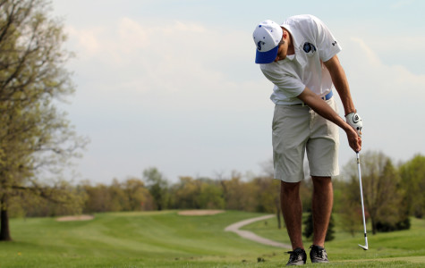 Cory Dickelman (11) putts on the practice range at Summer Tree in Crown Point.  JV won first place against Valparaiso.