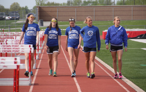 Maritza Castaneda (10), Abigail Peppin (10), Megan Zajac (10), Alaina Willis (12) and Hallee Willis (12) warm up around the track before the Duneland Athletic Conference meet. The girls are all part of the 4 x 8 meter relay, which placed first overall.