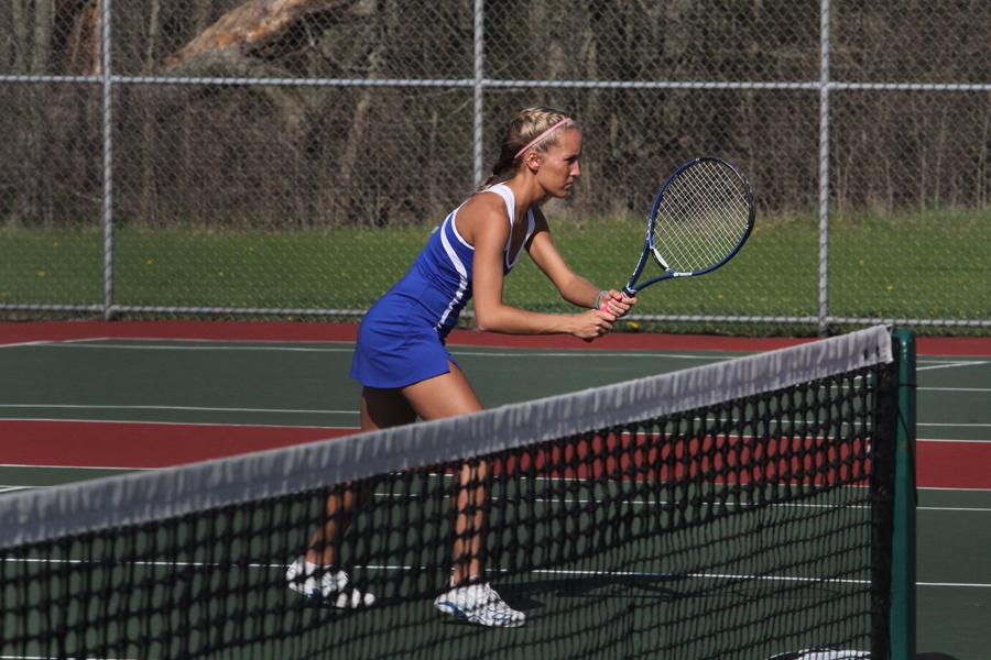 Nicole Stanek (12) prepares for the next rally.  Playing at 2 doubles, Stanek and her partner, Emma Rogers (12), won their match, gaining a point for the final varsity score.