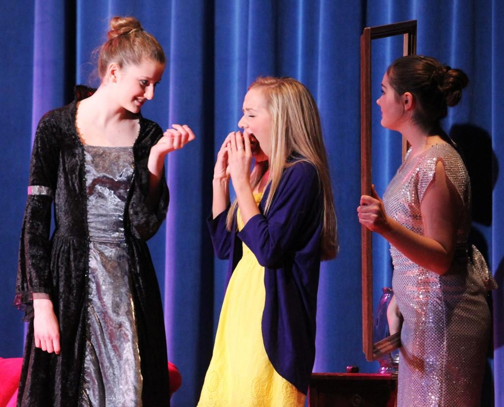 "Nichole Heusmann (9), Morgan Horgash (9) and Megan Barry (9) all star in the play ""Happily Never After""; Horgash takes the famous bite into the poisonous apple from the wicked queen. They presented this play on Friday, May 3."