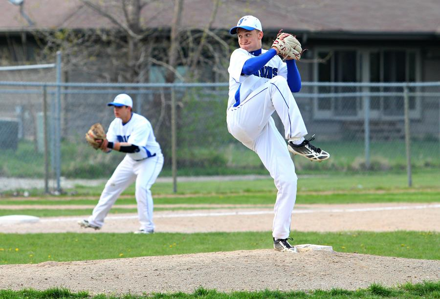 Blake+Bosold+%2811%29+winds+up+for+a+pitch+on+the+mound+at+the+May+2+home+game.++Facing+Merrillville%2C+the+boys+had+a+relaxed+game.++