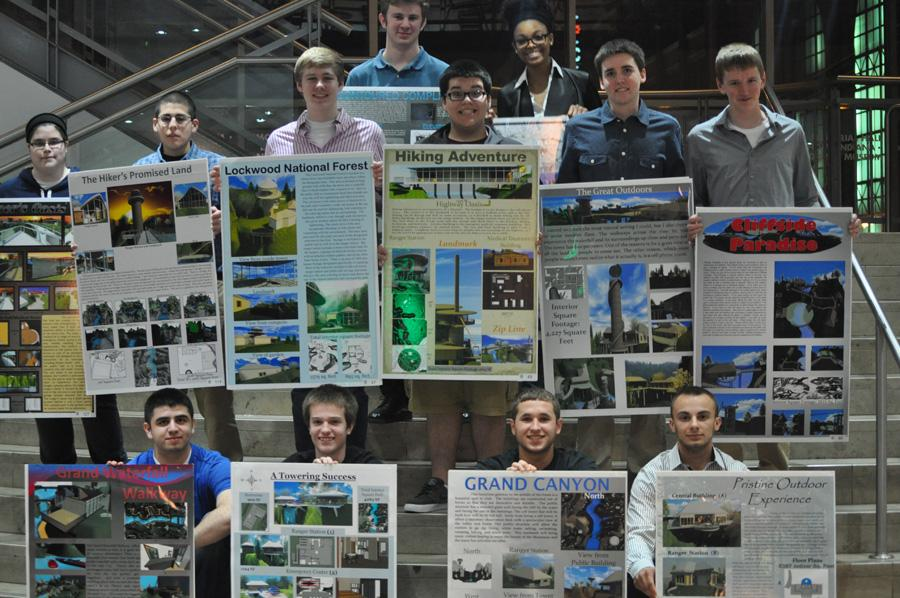 The attending finalists of the Indiana High School Architectural Design Competition pose for a photo with their projects.  The ceremony was held at the Indianapolis Artsgarden.