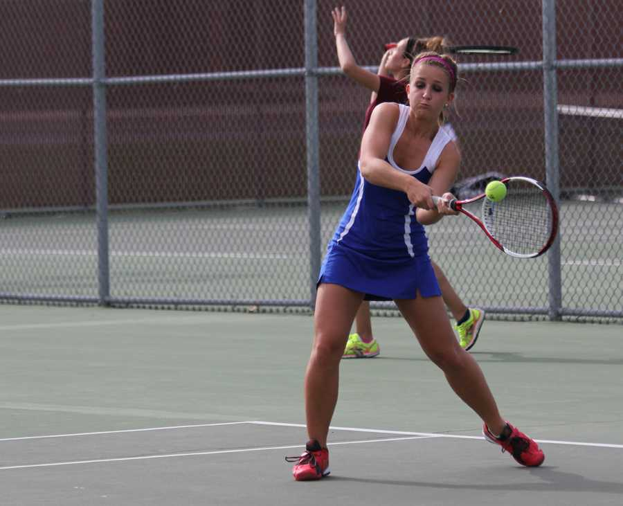 Kathryn Toth (12) executes a backhand during her match against Hanover Central.  Despite her loss, LC advanced to the next round of Sectionals.