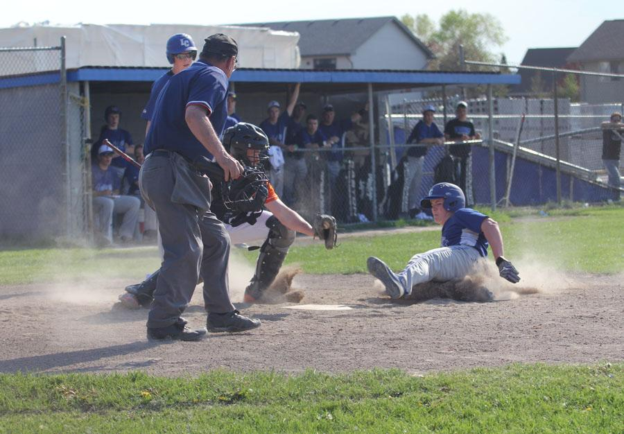 Zachary Turnbough (9) slides into home plate. The Indians beat the LaPorte Slicers 10-0 at home.