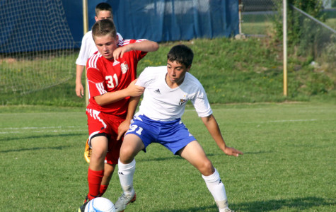 Eric Santiago (10) fights to take possession of the ball.  The JV boys tied 1-1 with Crown Point.