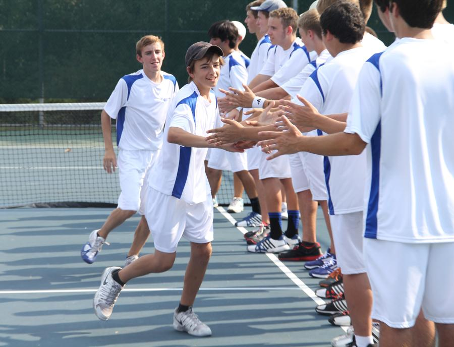 Chase Owczarzak (11) high fives his teammates before the match.  The final score was 0-5.