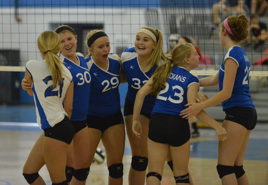 The JV team celebrates their win against Chesterton. The last game was close  and tense, but the girls won 25-22.