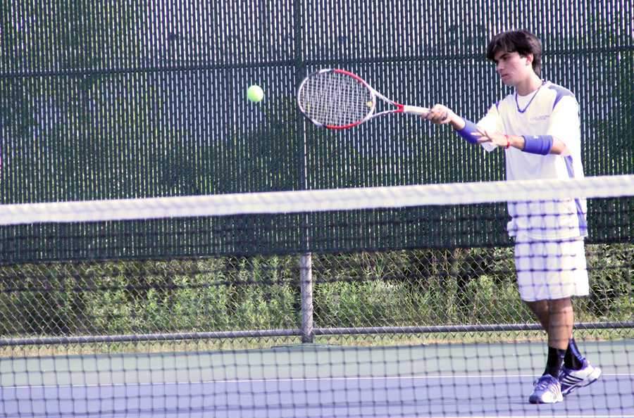 James+Lafakis+%2811%29+hits+the+ball+during+warm+ups.++Varsity+won+4-1+overall+and+JV+won+all+of+its+matches.