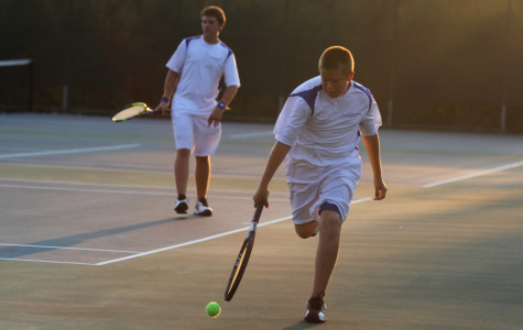 Nicholas Bradner (11) chases after a tennis ball during his match against Chesterton. Brandner and his doubles partner  Brett Balicki (10) lost their match with a score of 6-2.