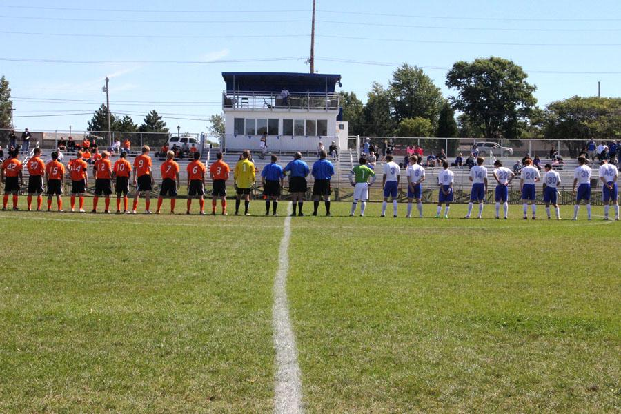 The LaPorte Slicers (left) and the Lake Central Indians (right) stand together in the starting lineup before Saturday's game. It was a close game, with two regulation overtime periods and a penalty shootout, but LC won 4-1 in penalties.