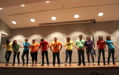 """Members of the group """"Play On Words"""" display their shirts to the audience. The improv show took place in the LGI on Sept. 25."""