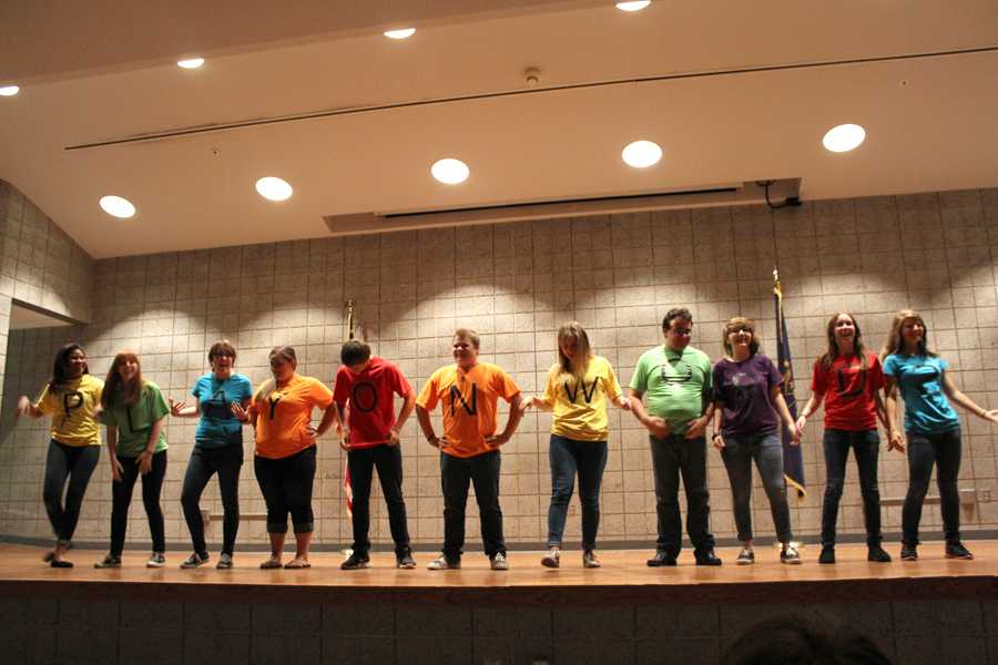 "Members of the group ""Play On Words"" display their shirts to the audience. The improv show took place in the LGI on Sept. 25."
