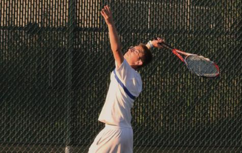 Raymond Pollalis (11) prepares for a serve at the Michigan City home match.  Pollalis played doubles alongside teammate Nicholas Brandner (11).