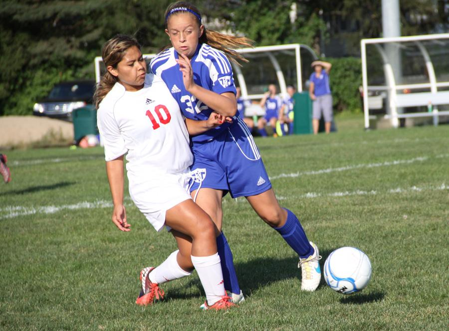 Hannah Lutz(9) fights her Munster opponent on September 5 at the girls' JV soccer game. The girls lost their game 5-0.