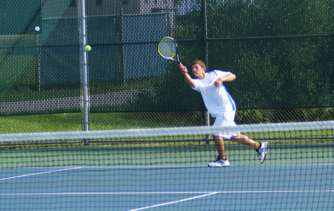 Brett Balicki (10) warms up before his match on Tuesday night. He and his doubles teammate, Nicholas Brandner (11) won their set.