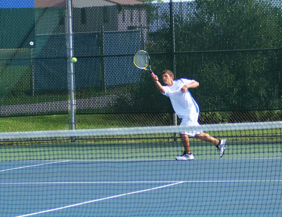 Brett+Balicki+%2810%29+warms+up+before+his+match+on+Tuesday+night.+He+and+his+doubles+teammate%2C+Nicholas+Brandner+%2811%29+won+their+set.+