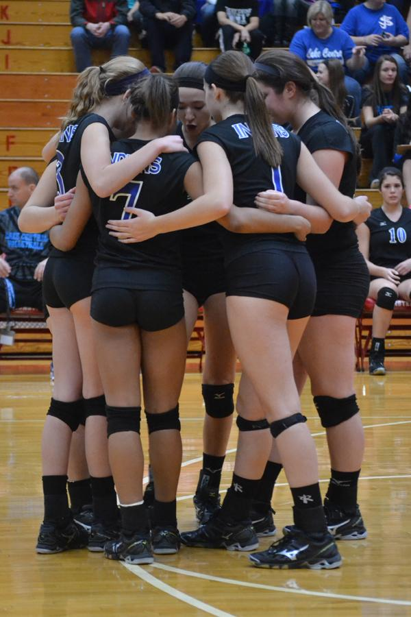 The six starters huddle up before the start of the game and  build each other up . The Sectional match was at Munster High School.
