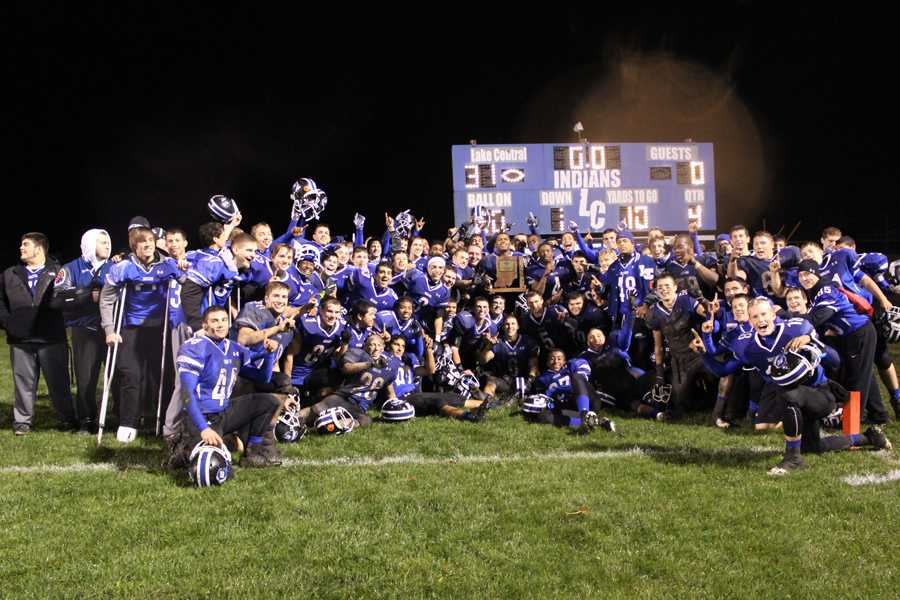 The football team poses for a photo after the game against Merrillville on Nov. 1. For the first time since 1999, the team captured the 2013 IHSAA 6A Sectional Championship.