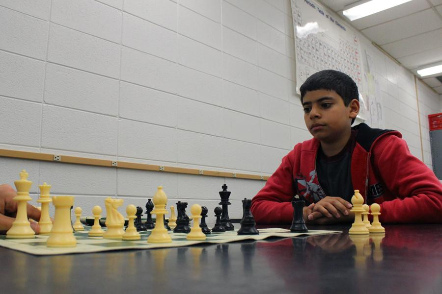 George+Beshara+%2810%29+watches+as+his+opponent+moves+his+piece+forward.++Beshara+eventually+won+against+his+opponent%2C+who+he+had+played+against+numerous+times+before.