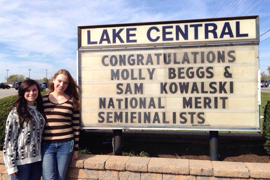 Samantha+Kowalski+%2812%29+and+Mary+Beggs+%2812%29+stand+in+front+of+Lake+Central%E2%80%99s+sign+which+recognizes+their+achievement+as+National+Merit+Scholar+semi-finalists.++The+two+girls+are+the+only+ones+at+Lake+Central+to+receive+this+honor+this+year.