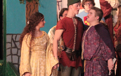 Prince John, played by Jackson DeLisle (10), looks at Robin Hood in disbelief, denying that he is no longer part of the royal family.  In this final scene, Robin Hood forced the Prince to leave the country with the help of some friends.