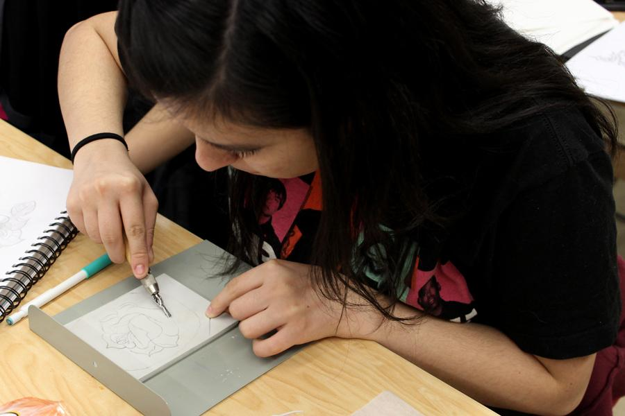 Jovana Dodevska (10) cuts out her rose from the linoleum.  This was the most time-consuming part of the project.