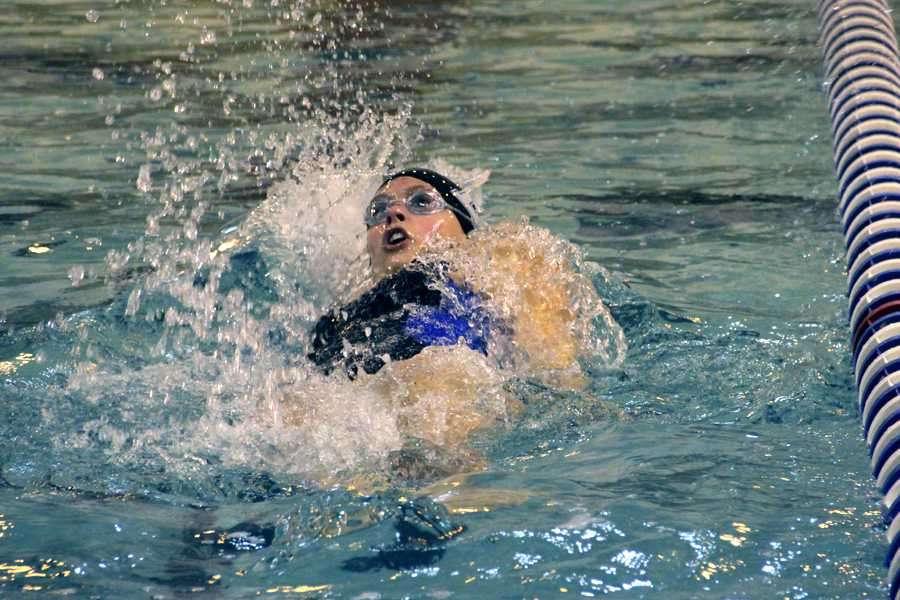 Hailey Garlich (11) swims the 100 backstroke at the girls swim meet on Nov. 26.  Garlich won her event with a time of 1:03.