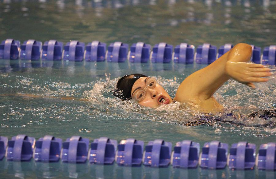 : Ariel Lara (11) competes in a relay.  For the 500 freestyle, she placed fifth.