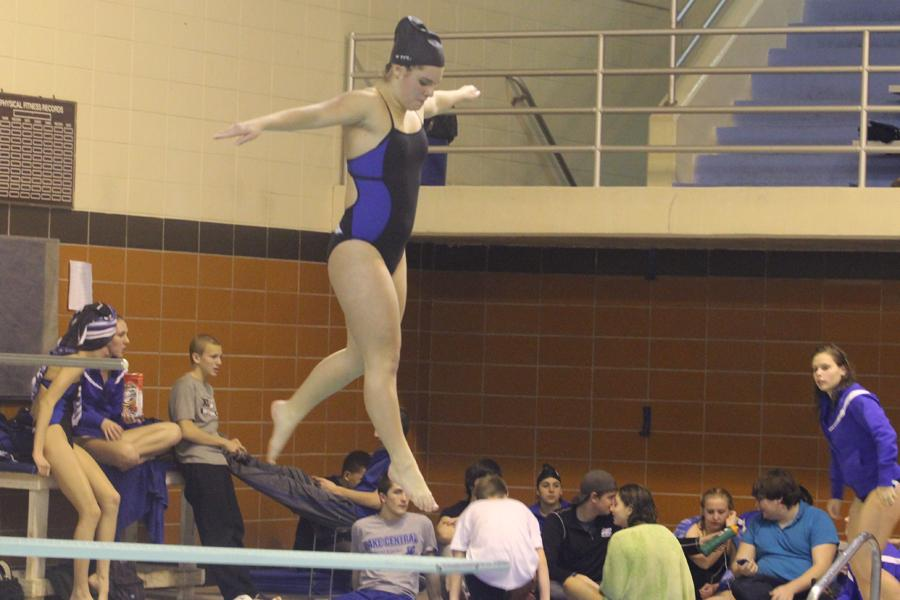 Hannah Leyba (10) prepares to take off into a dive as her fellow teammates sit around the divers for support.  She placed second in the diving portion of the meet.