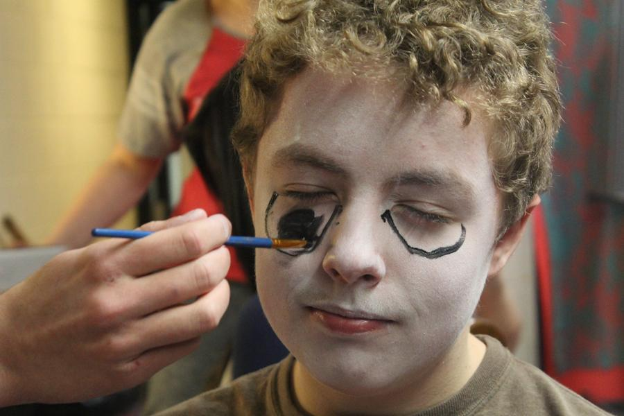 Christopher Young (9) gets his face painted in the theater makeup lab.  The students practiced with special effects makeup.