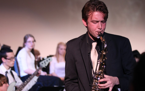 Zachary Nippert (12) stands for his saxophone solo during a Jazz I piece. The jazz students sometimes get to perform improvisational solos meaning that they get to make up the solo on the spot.