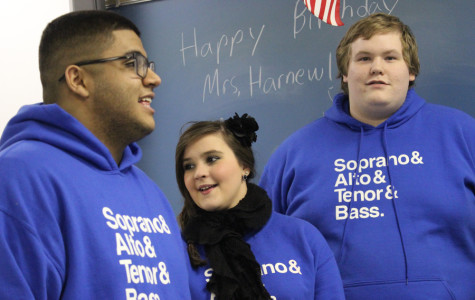 Justin Cortez (11), Caroline Janiga (12) and Charles Lobaugh (12) prepare to sing their final carol in Mrs. Stephanie Harnew's, Science, classroom. Counterpoints went caroling on Dec. 12, and gave a special performance for Mrs. Harnew's class at her request for her birthday.
