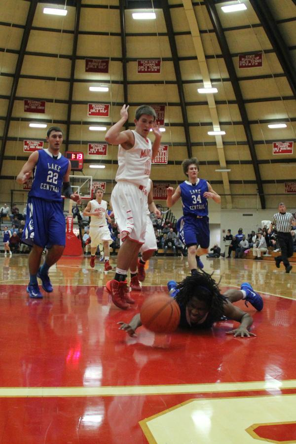 Robert Ryan (12) takes a tumble as he scrambles for the ball.  Lake Central defeated the Munster rivals 47-38.
