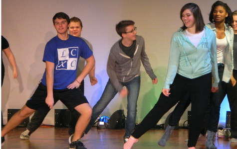 Brett Balicki (10), Lauren Bourget (12), Jackson DeLisle(10), Adam Gustus (9) and Kendra Williams (11) practice a dance for the musical during the first dance rehearsal in the auditorium. After going through the steps a few time, they began to get the hang of the dance