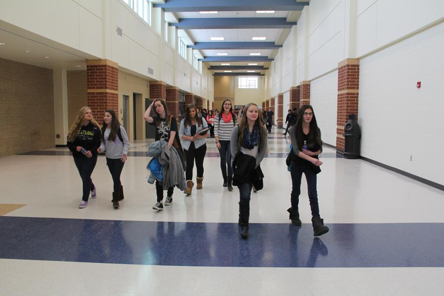 Students travel to get to class. This wide hallway, known as Main Street is an important factor of transportation from the freshman center to the new academic wing.