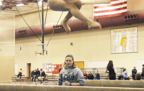 Maya Tobin (9) does a wolf jump during her beam routine.  She was happy with her score.