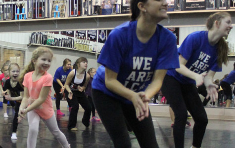 """Daniella Dombovic (12) and Genevieve Blessing (12) teach the dance to the girls in grades K-3 grade.  The girls danced to """"Hey Mickey"""" and  had fun while learning about  how to use technique."""