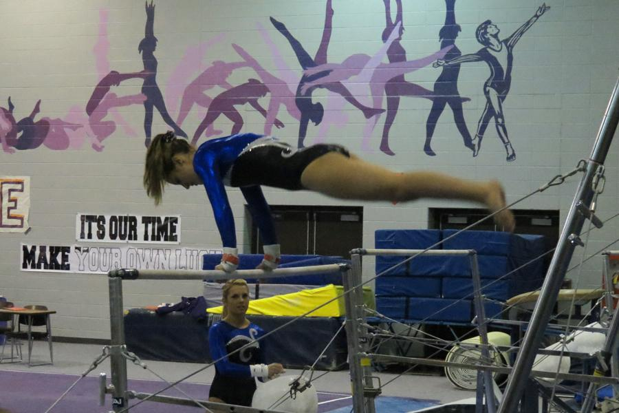 Megan+Misirly+%2810%29+performs+on+bars+at+the+meet+against+Merrillville.+The+meet+took+place+at+Merrillville+High+School+on+Jan.+23.
