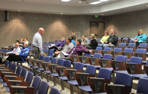 Faculty prepares to conduct the board meeting. Approximately 20 parents came to hear discussion of several different issues that affect their children.