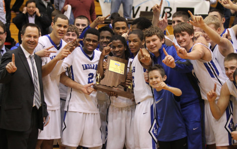 The boys basketball team and coaches