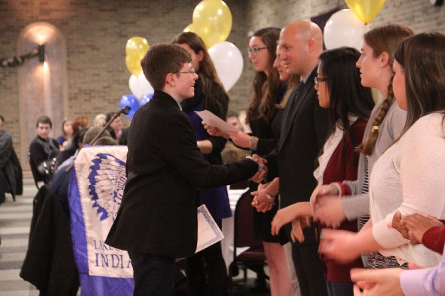 Sean Meyer (10) shakes hands with Mr. Robin Tobias, Principal, after accepting his certificate for receiving a 3.9 GPA or higher for at least one semester.  Meyer was a member of Academic Letterwinners, which recognizes students for having high grades.