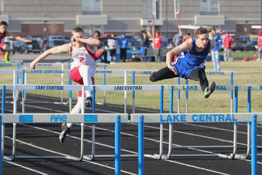 Kyle+West+%2811%29+runs+the+100-meter+hurdles+and+comes+in+first+place.++The+team+ended+up+winning+against+Portage%2C+but+losing+to+Crown+Point+by+two+points.