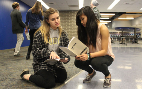 """Mia Gjeldum (12) and Jeannie Lam (9) go over stage directions for Gjeldum's freshman show, """"Cave Dream."""" Lam plays a part of a group of spelunkers that find themselves trapped in a cave."""