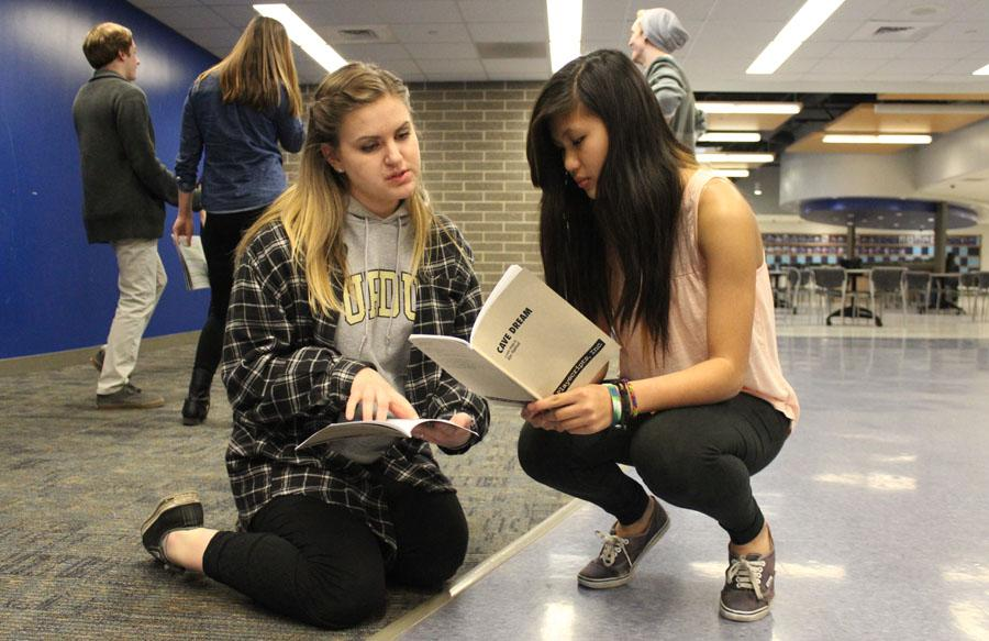 "Mia Gjeldum (12) and Jeannie Lam (9) go over stage directions for Gjeldum's freshman show, ""Cave Dream."" Lam plays a part of a group of spelunkers that find themselves trapped in a cave."