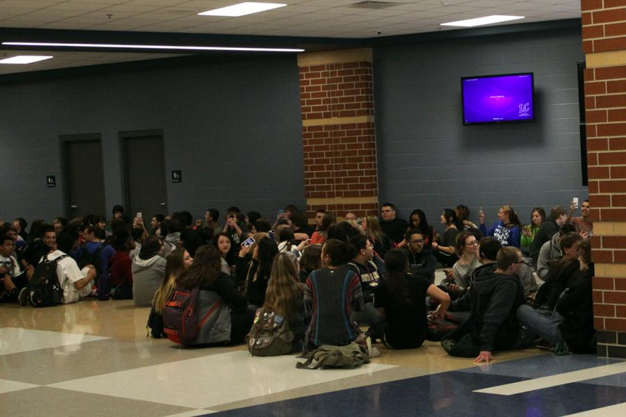 Students sit in the Wedge during a protest Wednesday, April 2 between D lunch and 4th period.