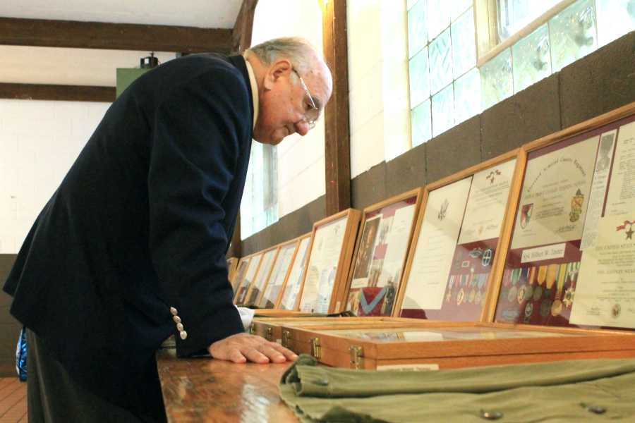 Indiana senator Frank Mrvan, takes a look at Mr. Tom Clark's, Social Studies, display. He also shared a speech at the opening ceremony before the walk.