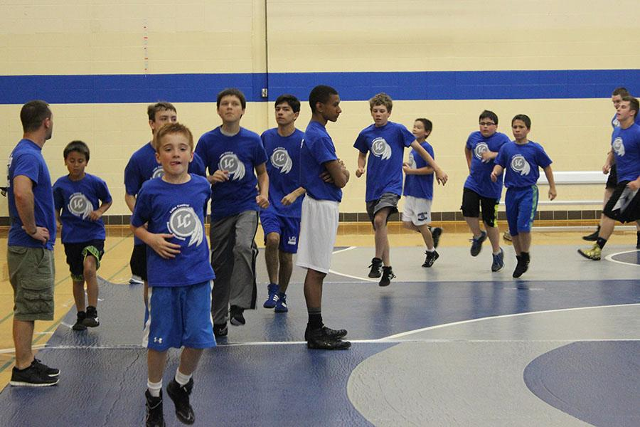 Boys+participating+in+wrestling+camp+run+laps+at+the+beginning+of+practice.+The+camp+lasted+4+days.
