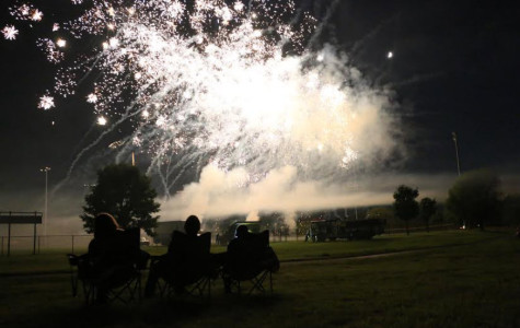 Three audience members view the Rohrman firework show up close and personal.  Schererville held their annual Independence Day celebration and firework show  at Rohrman park on Jul. 3.