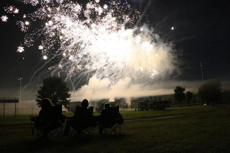Three+audience+members+view+the+Rohrman+firework+show+up+close+and+personal.++Schererville+held+their+annual+Independence+Day+celebration+and+firework+show++at+Rohrman+park+on+Jul.+3.